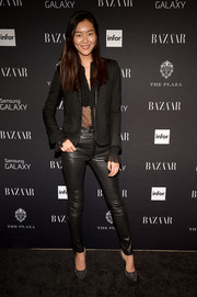 Liu Wen was edgy-sexy in black leather skinnies teamed with a sheer blouse at the Harper's Bazaar Icons event.