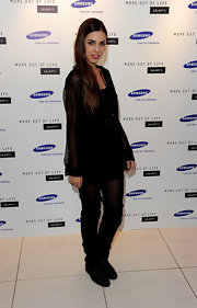 Model Amber Le Bon had her legs partially covered with a pair of over-the-knee boots at the Samsung launch party.