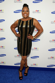 Sherri Shepherd teamed black ankle-cuff platform sandals with her dress for added sexiness.