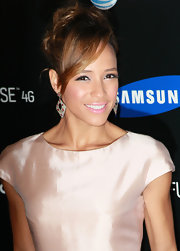 Dania Ramirez styled her hair in a loose bun and side swept bangs at the Samsung 4G launch.