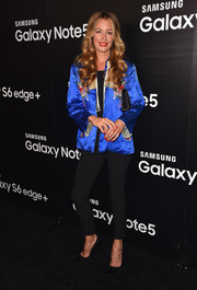 Cat Deeley brightened up her ensemble with an electric-blue Mandarin jacket.