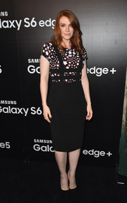 Bryce Dallas Howard paired her top with a black suspender pencil skirt.