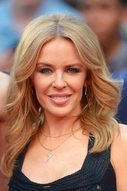 Kylie Minogue attended the 'San Andreas' UK premiere wearing a retro-chic wavy 'do.