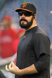 Brian warmed up for the Giants game wearing black sport shades.