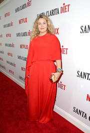 Drew Barrymore polished off her look with a gold Jimmy Choo clutch.