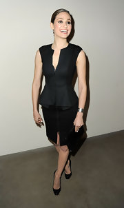Emmy Rossum looked particularly sharp at the Precognito gala wearing this black zippered peplum dress.