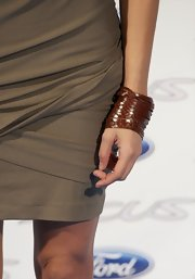 Sara rocked a brown leather bracelet which worled nicely with her mushroom hued dress.