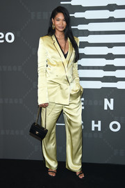 Chanel Iman styled her look with a boxy Chanel bag.
