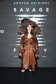 Dascha Polanco rocked a shiny brown trenchcoat and a statement hat at the Savage X Fenty show.