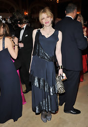 Courtney channels 20's glamour in a shimmering tiered evening dress at the Plaza Hotel in NYC.