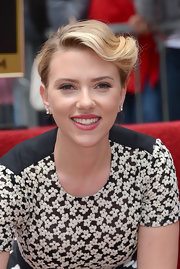 Scarlett Johansson added a touch of berry-colored lip stain to her barely-there makeup look.