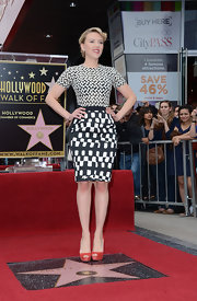 Scarletty Johansson completed her black and white ensemble with red suede peep toe pumps.