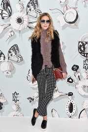 Olivia Palermo finished off her funky outfit with a pair of black patent flatforms by Sol Sana.
