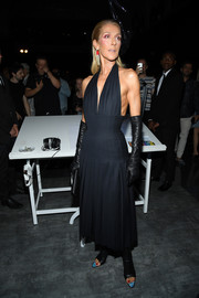 Celine Dion attended the Schiaparelli Couture Fall 2019 show wearing a sexy black halter dress.