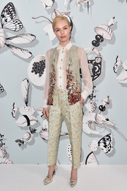 Kate Bosworth added more glamour with a pair of bedazzled gold pumps by Roger Vivier.