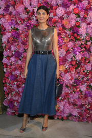 Giovanna Battaglia's full denim skirt worked stylishly with her silver top.