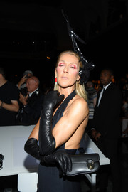 Celine Dion's black leather gloves gave her outfit a dose of edge.