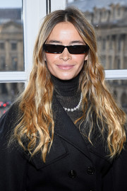 Miroslava Duma opted for a casual wavy hairstyle when she attended the Schiaparelli Couture show.