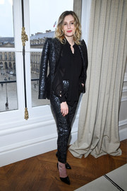Laura Carmichael was punk-glam in a metallic pantsuit at the Schiaparelli Couture show.