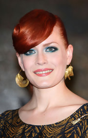 Ana Matronic wore a complementary hue to brighten her look for an appearance in London. The shimmering teal shadow was the perfect option to pair with her fiery tresses and glossy coral lipstick.