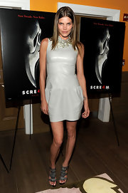 May attended the screening of 'Scream 4' in a high-fashion coated dress that stood out with its shiny fabric.