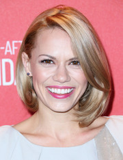Bethany Joy Lenz beams in her golden bob that perfectly framers her face.