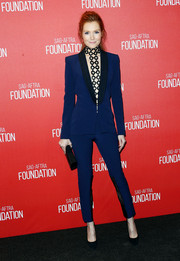 Darby Stanchfield stunned in a plunging deep V-neck royal blue pantsuit with black lining along the edges.