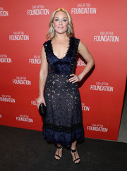 Elisabeth Rohm kept it classy at the SAG Foundation 30th anniversary celebration in a navy cocktail dress with a patterned skirt and a feathered bodice and hem.