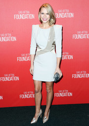 Bethany Joy Lenz rocks the pointed shoulder pad look in this long-sleeved pale blue dress