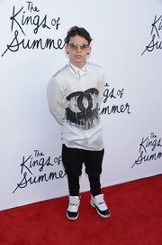 Moises Arias chose a classic white button down with painted Chanel C's for a cool punk-inspired look.