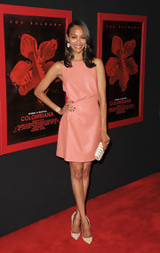 Zoe Saldana accessorized her leather Valentino dress with classic beige pumps.