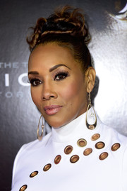 Vivica A. Fox attended the screening of 'Concussion' rocking an elaborate top knot.