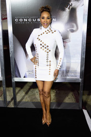 Vivica A. Fox put her fabulous figure on display at the screening of 'Concussion' in a body-con white Mugler mini dress with grommet detailing.