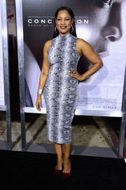 Garcelle Beauvais sheathed her curves in a gray snakeskin-print dress for the screening of 'Concussion.'