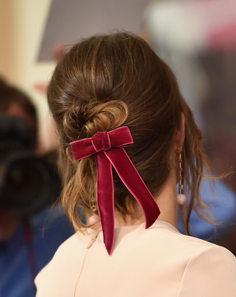 Mandy Moore sported a twisted bun complete with a red velvet bow at the screening of 'Tangled Before Ever After.'