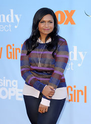 Mindy Kaling looked like a gem in this striped jewel-toned sweater.