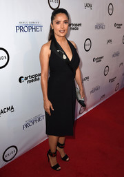 Black peep-toe heels with metal-accented ankle cuffs completed Salma Hayek's red carpet look.