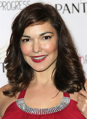 Instead of classic red, Laura Elena Harring opted for a shiny cranberry shade of lipcolor.
