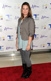 Ashley Williams pulled off a fall-inspired outfit featuring a gray cropped jacket with satin-trimmed sleeves.