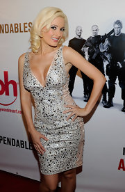 Holly wore a beaded cocktail dress with her signature platinum curls.