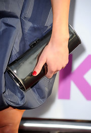 Katheryn paired her navy dress with a metallic box clutch.