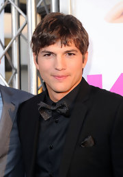 "Ashton Kutcher showed off his tapered haircut while walking the red carpet at the ""Killers' premiere."