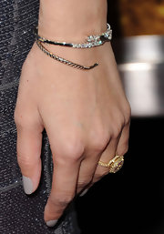 Noureen DeWulf wore a gold snake bracelet with diamond embellishments at the 'The Lincoln Lawyer' screening.