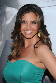 Charisma showed off her long center part curls while hitting the premiere of 'The Last Exorcism'.