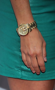 Charisma showed off her gold timeless watch.