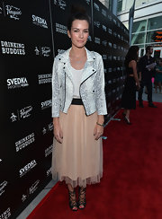 Kelly blended rock and feminine flare by pairing a gray and white snakeskin motorcycle with a girly skirt.