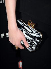 Kirsten Dunst added some color and pattern to her all-black look with this black and white swirl clutch.