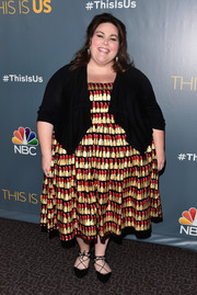 Chrissy Metz topped off her dress with a black shawl-collar cardigan.