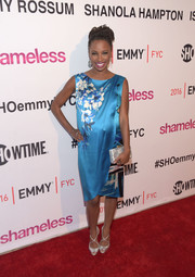Shanola Hampton sealed off her look with a metallic silver clutch.