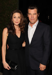 Diane Lane looked classically glam carrying a black patent clutch.